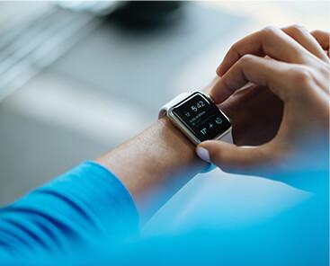woman checking smart watch